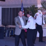 Mayor Newberry presents Rick Ladell with a 911 special recognition.